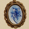 Blue Ink Flower on a Brass Pendant