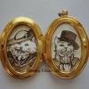 Mr. and Mrs. Prrrston in Filigree Locket